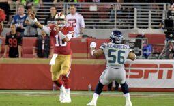Nov 11, 2019; Santa Clara, CA, USA; San Francisco 49ers quarterback Jimmy Garoppolo (10) throws a pass over Seattle Seahawks linebacker Mychal Kendricks (56) during the first half at Levi's Stadium. Mandatory Credit: Kirby Lee-USA TODAY Sports