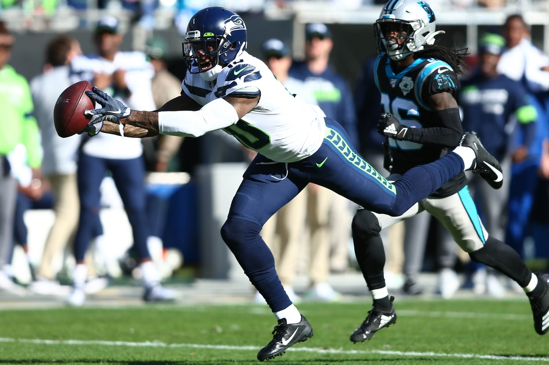 Dec 15, 2019; Charlotte, NC, USA; Seattle Seahawks wide receiver Josh Gordon (10) catches a pass against Carolina Panthers cornerback Donte Jackson (26) during the second quarter at Bank of America Stadium. Mandatory Credit: Jeremy Brevard-USA TODAY Sports