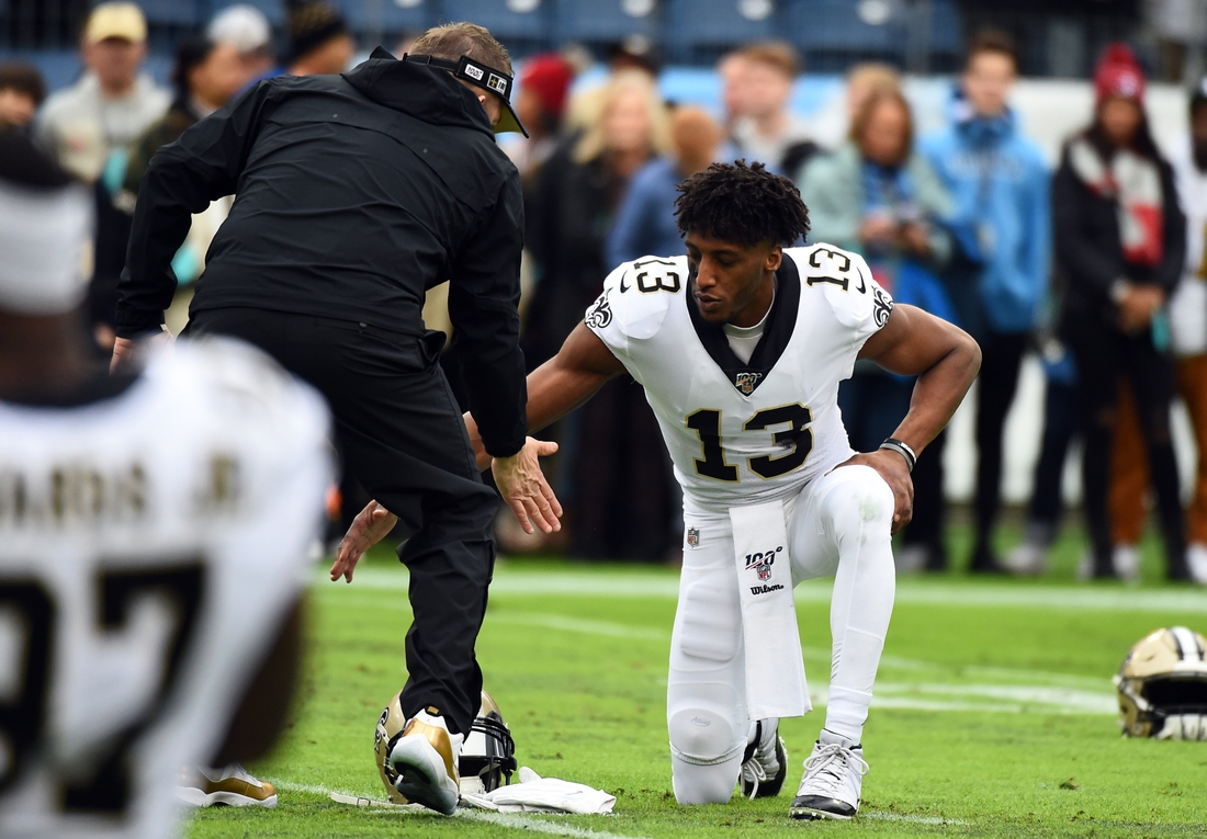 Dec 22, 2019; Nashville, Tennessee, USA; New Orleans Saints wide receiver Michael Thomas (13) and New Orleans Saints head coach Sean Payton slap hands before the game against the Tennessee Titans at Nissan Stadium. Mandatory Credit: Christopher Hanewinckel-USA TODAY Sports