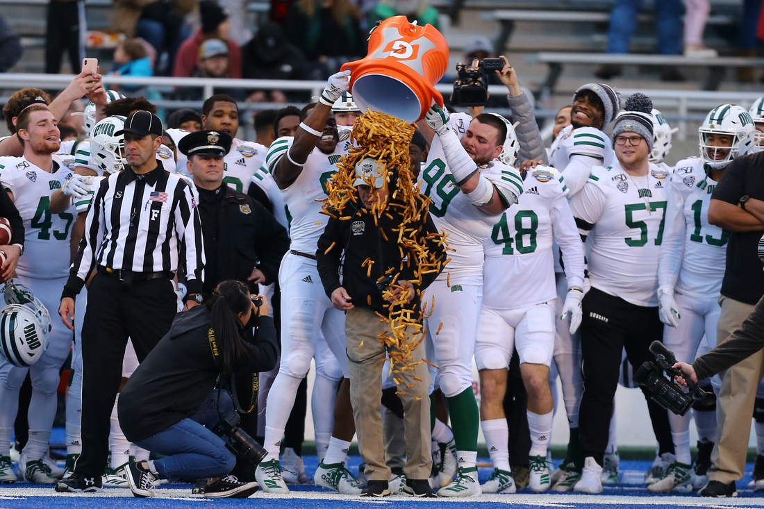 Jan 3, 2020; Boise, Idaho, USA; Ohio Bobcats players dump french fries on head coach Frank Solich during the second half of the Famous Idaho Potato Bowl against the Nevada Wolf Pack at Albertsons Stadium. Ohio won 30-21. Mandatory Credit: Brian Losness-USA TODAY Sports