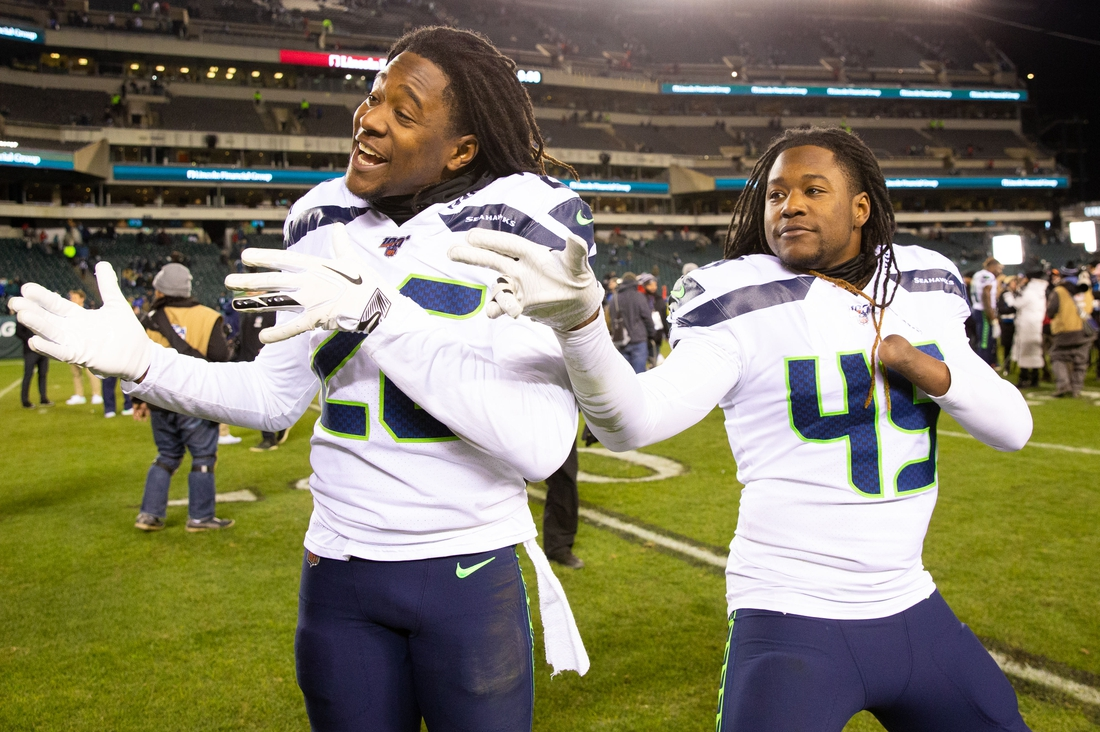 Jan 5, 2020; Philadelphia, Pennsylvania, USA; Seattle Seahawks cornerback Shaquill Griffin (26) and outside linebacker Shaquem Griffin (49) celebrate a victory against the Philadelphia Eagles in a NFC Wild Card playoff football game at Lincoln Financial Field. Mandatory Credit: Bill Streicher-USA TODAY Sports