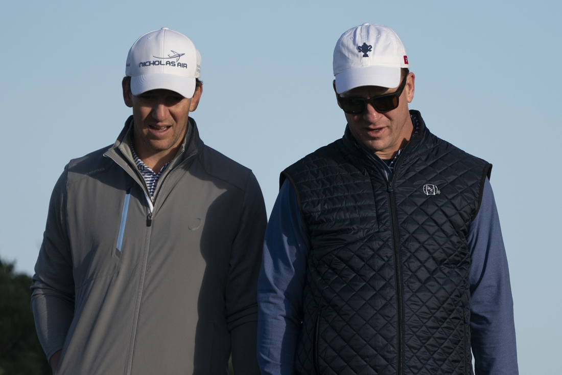 February 7, 2020; Pebble Beach, California, USA; Eli Manning (left) and Peyton Manning (right) walk on the 11th hole during the second round of the AT&T Pebble Beach Pro-Am golf tournament at Monterey Peninsula Country Club - Shore Course. Mandatory Credit: Kyle Terada-USA TODAY Sports