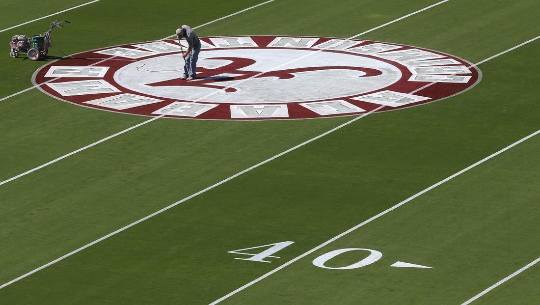 The University of Alabama showed off renovations to Bryant Denny Stadium Thursday, Oct. 1, 2020. A painter sprays the logo onto mid-field. [Staff Photo/Gary Cosby Jr.]  Bryant Denny Stadium Renovations