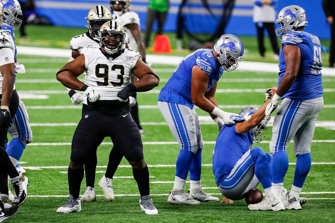 New Orleans Saints defensive tackle David Onyemata (93) celebrates his sack of Detroit Lions quarterback Matthew Stafford, right, during the second half Sunday, October 4, 2020 at Ford Field.  10042020 Sad Detroit Lions