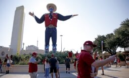 Oct 10, 2020; Dallas, Texas, USA;  Fans walk past Big Tex before the Red River Showdown college football game between the Oklahoma Sooners (OU) and the Texas Longhorns (UT) at Cotton Bowl Stadium in Dallas, Saturday, Oct. 10, 2020. Mandatory Credit: Bryan Terry-USA TODAY NETWORK