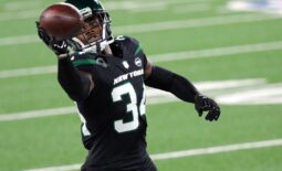 Nov 9, 2020; East Rutherford, New Jersey, USA; New York Jets cornerback Brian Poole (34) makes a one-handed catch during practice before the game against the New England Patriots at MetLife Stadium. Mandatory Credit: Kevin R. Wexler/NorthJersey.com via USA TODAY NETWORK