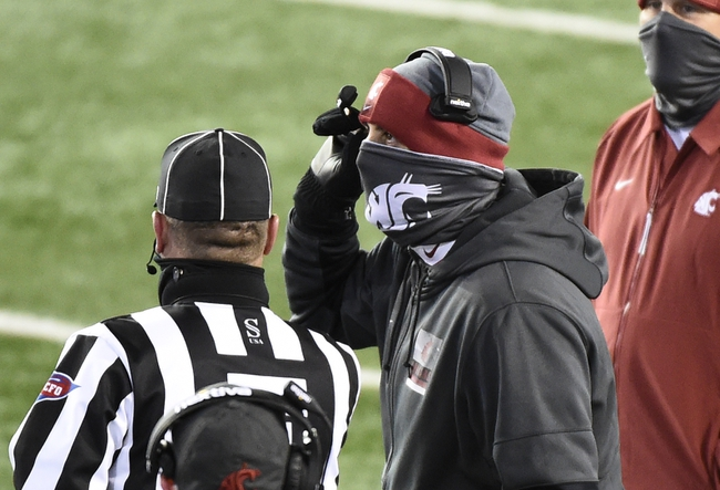 Nov 14, 2020; Pullman, Washington, USA;Washington State Cougars head coach Nick Rolovich talks with an official during a game against the Oregon Ducks in the first half at Martin Stadium. Mandatory Credit: James Snook-USA TODAY Sports
