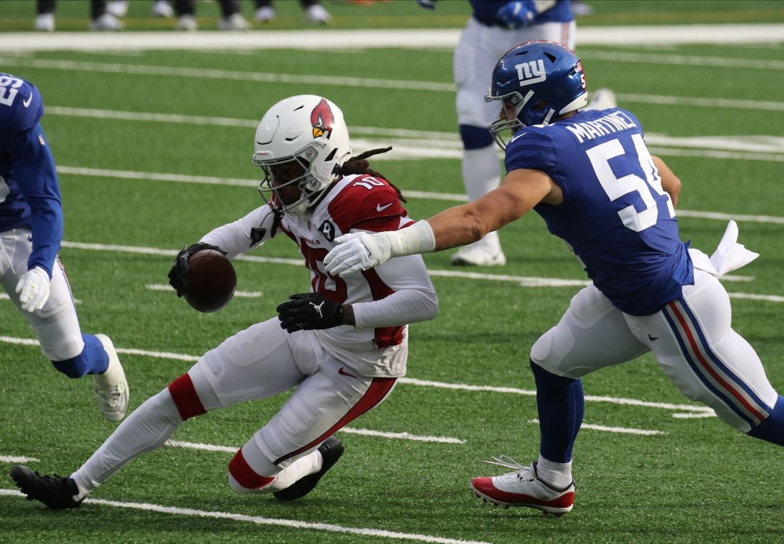 DeAndre Hopkins of the Cardinals runs after the catch and is tackled by Blake Martinez of the Giantsin the first half as the Arizona Cardinals played the New York Giants at MetLife Stadium in East Rutherford, NJ on December 13, 2020.  The Arizona Cardinals Vs New York Giants At Metlife Stadium In East Rutherford Nj On December 13 2020