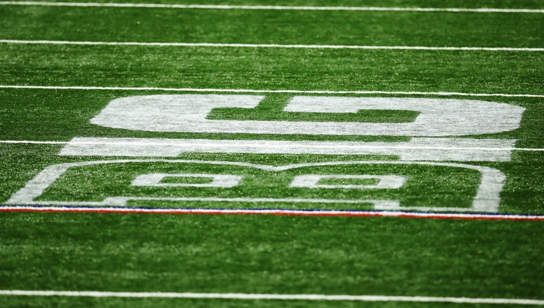 Dec 19, 2020; Indianapolis, Indiana, USA; The Big 10 Conference logo is seen on the field during the first half between the Ohio State Buckeyes and the Northwestern Wildcats at Lucas Oil Stadium. Mandatory Credit: Aaron Doster-USA TODAY Sports