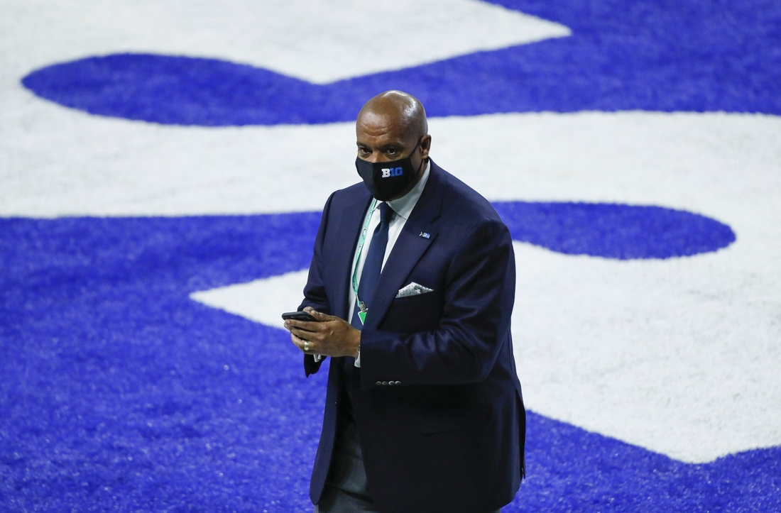 Big Ten commissioner Kevin Warren walks across the endzone prior to the Big Ten Championship football game between Ohio State and Northwestern at Lucas Oil Stadium in Indianapolis on Saturday, Dec. 19, 2020.  Big Ten Championship Ohio State Northwestern