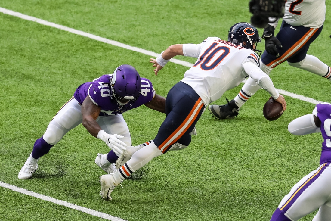 Dec 20, 2020; Minneapolis, Minnesota, USA; Chicago Bears quarterback Mitchell Trubisky (10) is sacked by Minnesota Vikings linebacker Todd Davis (40) during the first quarter at U.S. Bank Stadium. Mandatory Credit: Brace Hemmelgarn-USA TODAY Sports