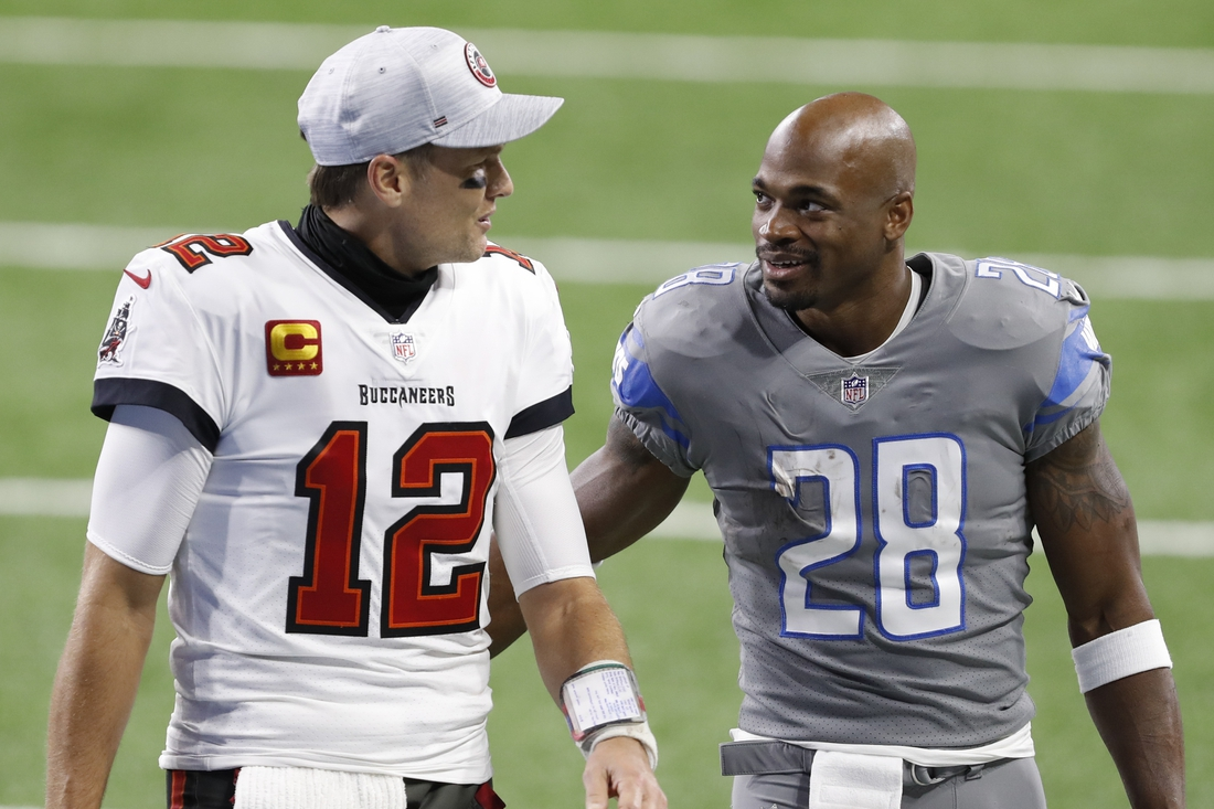 Dec 26, 2020; Detroit, Michigan, USA; Detroit Lions running back Adrian Peterson (28) talks with Tampa Bay Buccaneers quarterback Tom Brady (12) after the game at Ford Field. Mandatory Credit: Raj Mehta-USA TODAY Sports