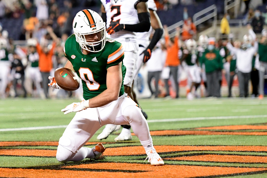 Dec 29, 2020; Orlando, FL, USA; Miami Hurricanes wide receiver Marshall Few (0) reacts after running the ball in for a two-point conversion during the second half against the Oklahoma State Cowboys during the Cheez-It Bowl Game at Camping World Stadium. Mandatory Credit: Douglas DeFelice-USA TODAY Sports