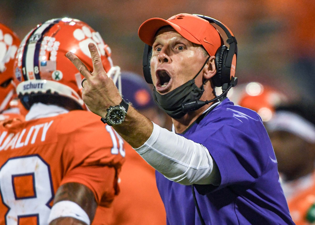 Clemson defensive coordinator Brent Venables communicates with players in the Virginia game during the fourth quarter of the game Saturday, October 3, 2020 at Memorial Stadium in Clemson, S.C.Clemson Virginia Ncaa Football