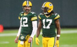 Jan 16, 2021; Green Bay, Wisconsin, USA; Green Bay Packers quarterback Aaron Rodgers (12) and wide receiver Davante Adams (17) against the Los Angeles Rams during the NFC Divisional Round at Lambeau Field. Mandatory Credit: Mark J. Rebilas-USA TODAY Sports