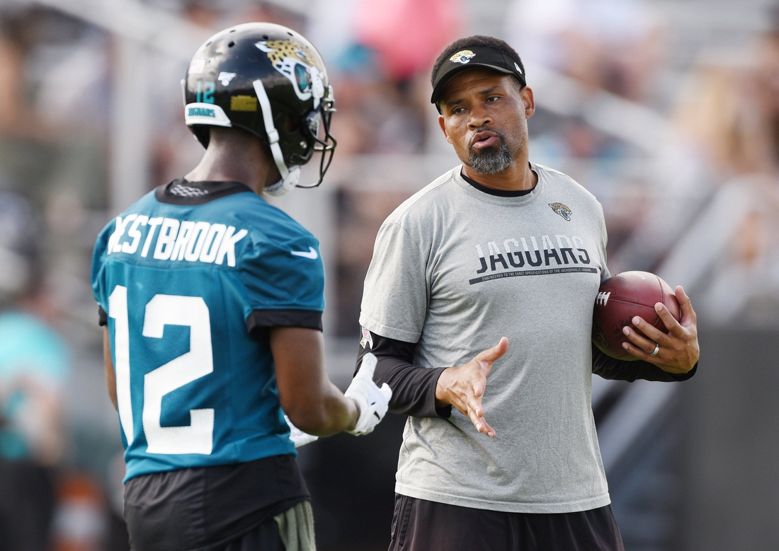 Jaguars #12, Dede Westbrook gets instructions from wide receivers coach Keenan McCardell during Tuesday morning's minicamp session. The Jacksonville Jaguars held their first day of 2019 mandatory minicamp at the practice fields by TIAA Bank Field Tuesday, June 11, 2019. [Bob Self/Florida Times-Union]  Fl Jax Jagsmandatoryminica 1