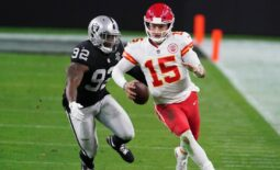 Nov 22, 2020; Paradise, Nevada, USA; Kansas City Chiefs quarterback Patrick Mahomes (15) is pursued by Las Vegas Raiders defensive end Chris Smith (92) at Allegiant Stadium. Mandatory Credit: Kirby Lee-USA TODAY Sports