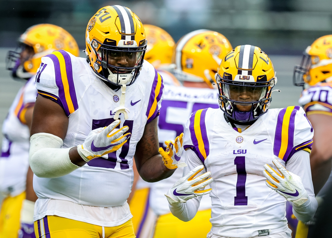 Apr 17, 2021; Baton Rouge, Louisiana, USA;  LSU Tigers offensive tackle Dare Rosenthal (51) and LSU Tigers wide receiver Kayshon Boutte (1) pose for the camera on a time out during the first half of the annual Purple and White spring game at Tiger Stadium. Mandatory Credit: Stephen Lew-USA TODAY Sports