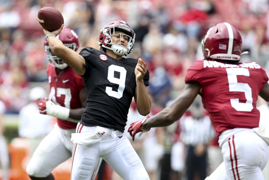 Apr 17, 2021; Tuscaloosa, Alabama, USA; White quarterback Bryce Young (9) throws over Crimson defensive back Jalyn Armour-Davis (5) during the Alabama A-Day game at Bryant-Denny Stadium. Mandatory Credit: Gary Cosby-USA TODAY Sports