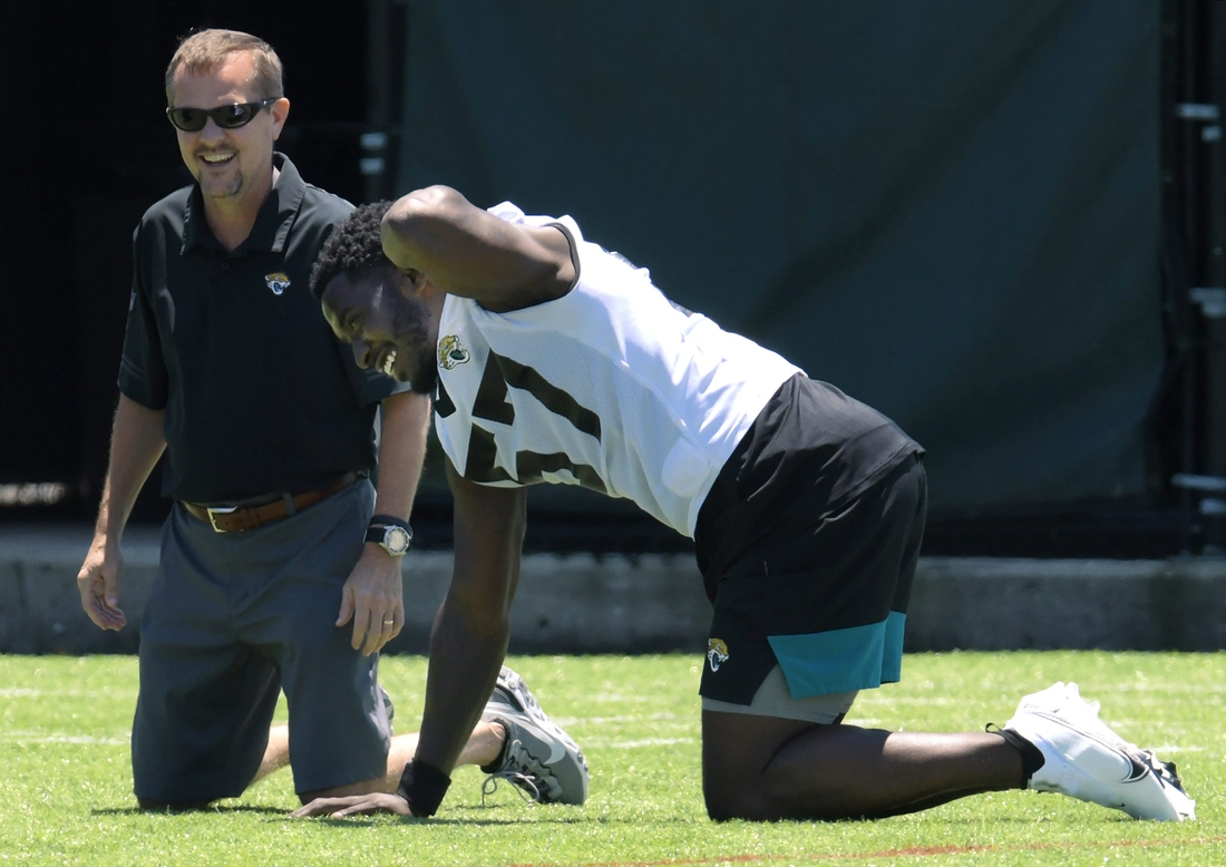 Jaguars line backer #57, Dylan Moses goes through stretching drills during Saturday's Rookie Minicamp session. The Jacksonville Jaguars held their Saturday 2021 Rookie Minicamp session at the practice fields outside TIAA Bank Field Saturday, May 15, 2021.  Jki 051521 Jaguarsrookiecamp 22