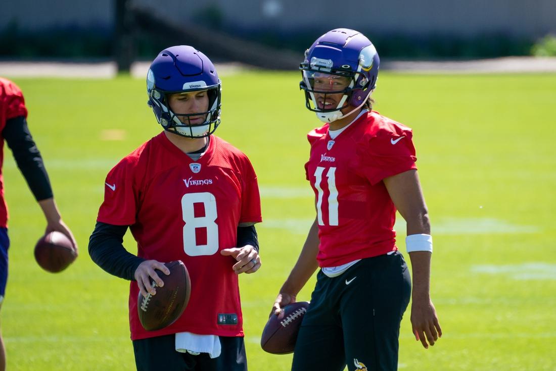 May 26, 2021; Eagan, Minnesota, USA; Minnesota Vikings quarterback Kirk Cousins (8) and quarterback Kellen Mond (11) participate in drills at OTA at TCO Performance Center. Mandatory Credit: Brad Rempel-USA TODAY Sports