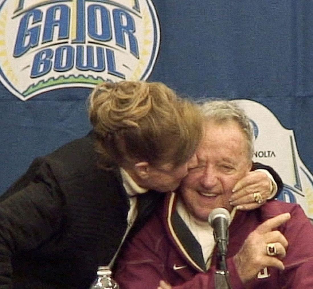 Jan. 1, 2010: Legendary Florida State University football coach Bobby Bowden's wife, Ann, gives him a kiss during the post game press conference after his final game against West Virginia at Jacksonville Municipal Stadium for the Gator Bowl. [Kelly Jordan, Florida Times-Union]