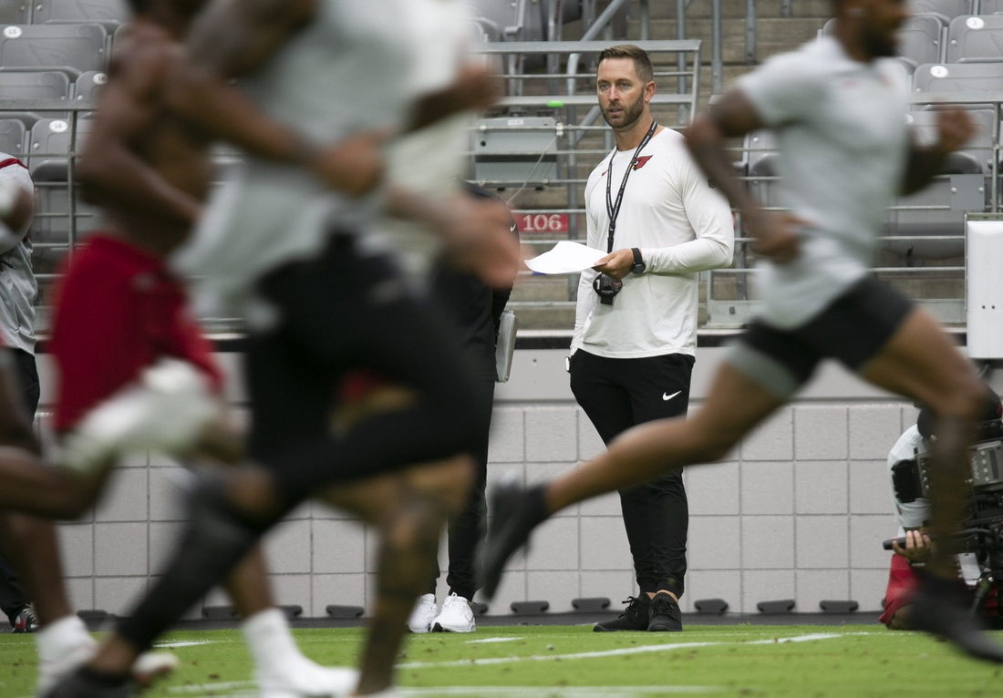 Cardinals head coach Kliff Kingsbury watches players during a run test as Cardinals players report for camp at State Farm Stadium In Glendale on July 27, 2021.  Cardinals Report