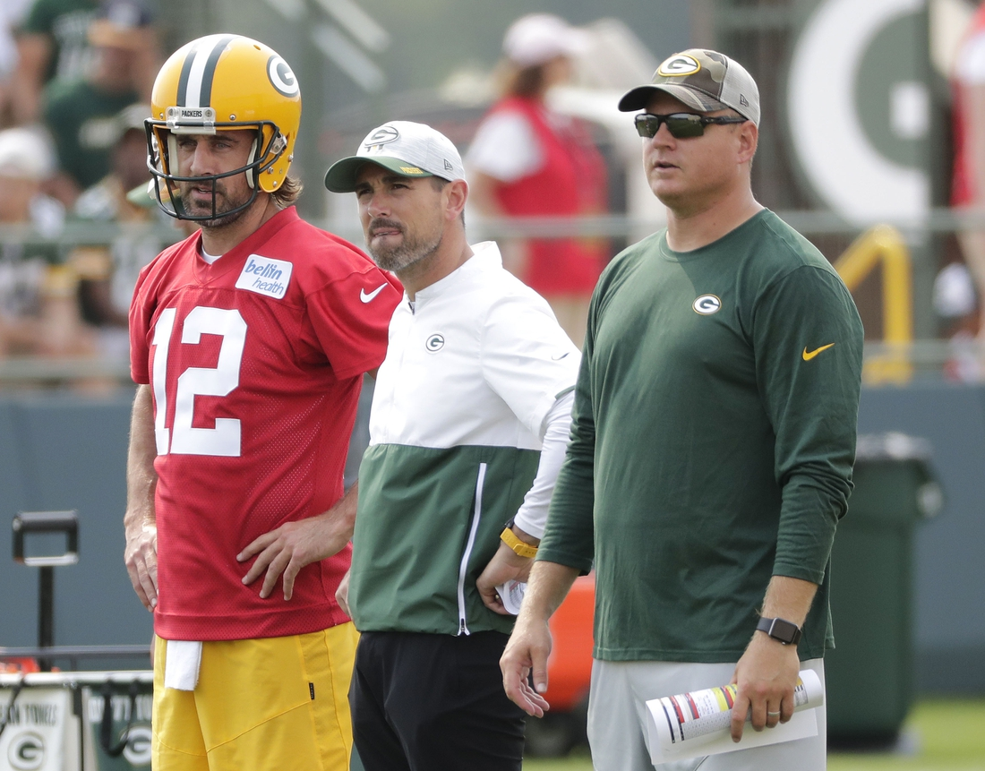 July 28, 2021; Green Bay, WI, USA; Green Bay Packers quarterback Aaron Rodgers (12), head coach Matt LaFleur and quarterbacks coach Luke Getsy, right, participate in training camp Wednesday, July 28, 2021, in Green Bay, Wis. Mandatory Credit: Dan Powers-USA TODAY NETWORK