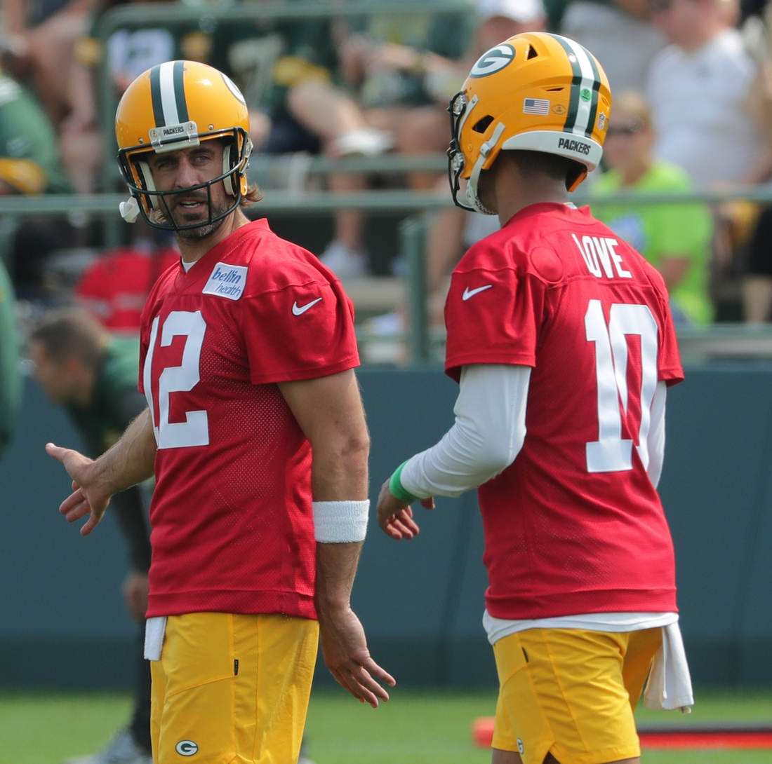 Jul 28, 2021; Green Bay, WI, USA; Green Bay Packers quarterback Aaron Rodgers (12) talks with quarterback Jordan Love (10) during the first day of training camp. Mandatory Credit: Mark Hoffman/Milwaukee Journal Sentinel-USA TODAY NETWORK