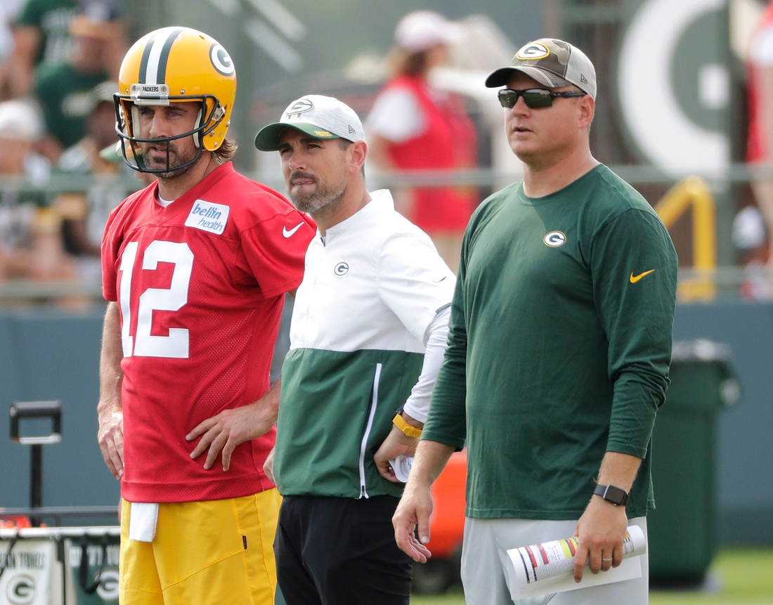Green Bay Packers quarterback Aaron Rodgers, head coach Matt LaFleur and quarterbacks coach Luke Getsy look on during Wednesday's practice.  Nfl Green Bay Packers Training Camp