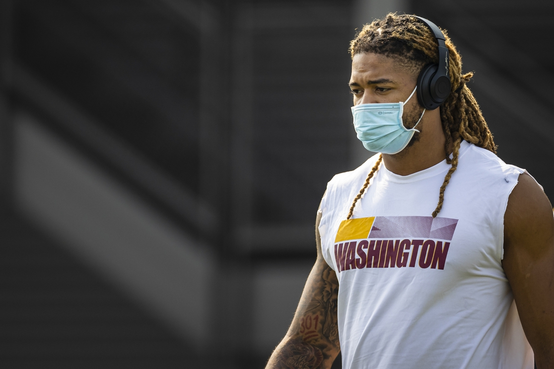 Jul 29, 2021; Richmond, VA, USA; Washington Football Team defensive end Chase Young (99) wears a face mask as he retrieves his jersey during training camp at Bon Secours Washington Redskins Training Cennter. Mandatory Credit: Scott Taetsch-USA TODAY Sports