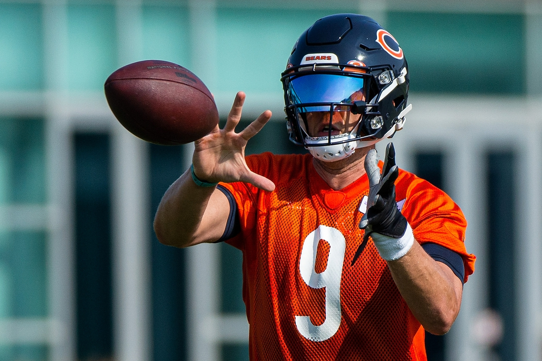 Jul 29, 2021; Lake Forest, IL, USA; Chicago Bears quarterback Nick Foles (9) catches the ball during a Chicago Bears training camp session at Halas Hall. Mandatory Credit: Jon Durr-USA TODAY Sports