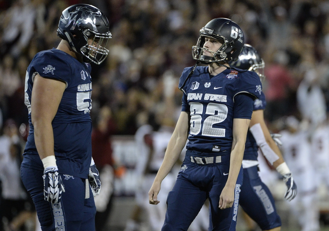 Dec 29, 2017; Tucson, AZ, USA; Utah State Aggies place kicker Dominik Eberle (62) reacts after missing a field goal during overtime in the 2017 Arizona Bowl against the New Mexico State Aggies at Arizona Stadium. Mandatory Credit: Casey Sapio-USA TODAY Sports