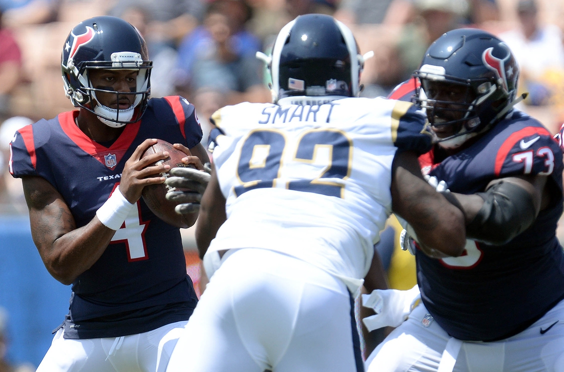 August 25, 2018; Los Angeles, CA, USA; Houston Texans quarterback Deshaun Watson (4) moves out to pass as offensive guard Zach Fulton (73) provides coverage against Los Angeles Rams defensive tackle Tanzel Smart (92) during the first half at Los Angeles Memorial Coliseum. Mandatory Credit: Gary A. Vasquez-USA TODAY Sports