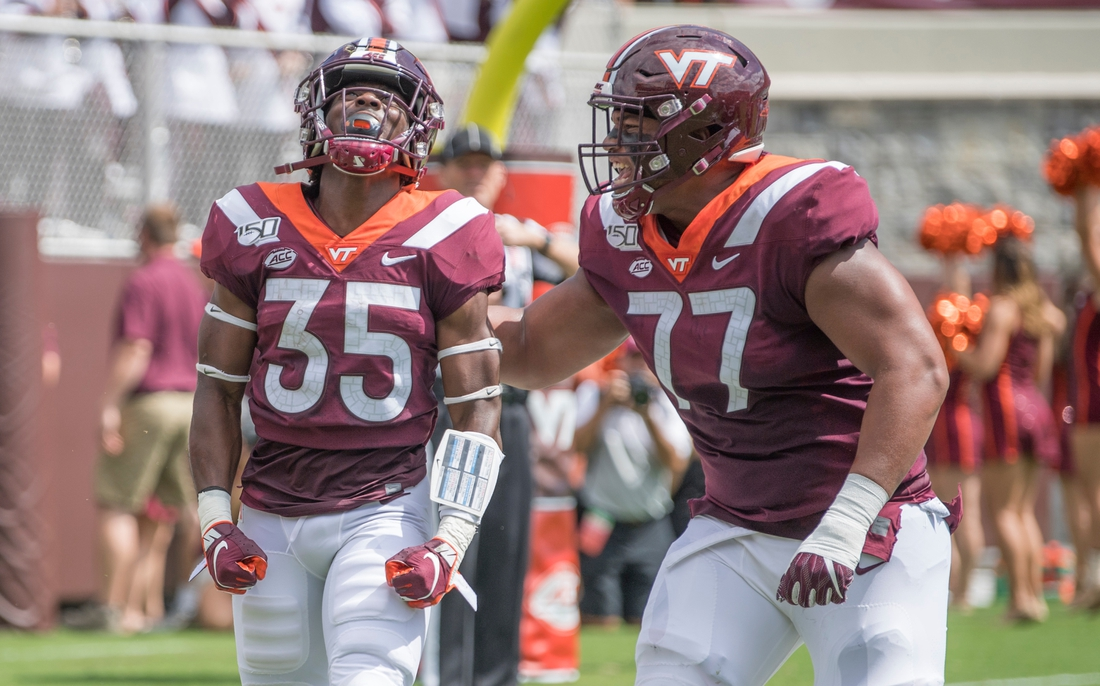 Sep 7, 2019; Blacksburg, VA, USA; Virginia Tech Hokies running back Keshawn King (35) celebrates his first touch down with Christian Darrisaw (77) in the first period against the Old Dominion Monarchs at Lane Stadium. Mandatory Credit: Lee Luther Jr.-USA TODAY Sports