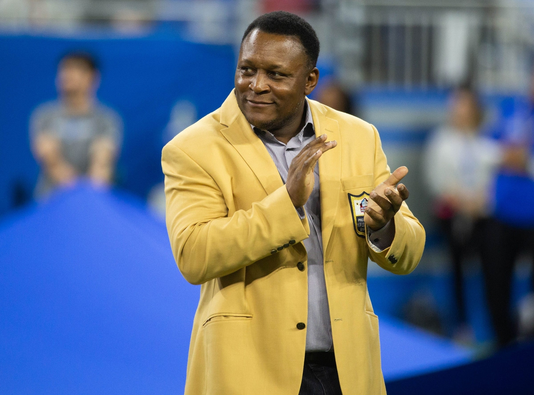 Former Detroit Lions running back Barry Sanders applauds during a halftime presentation at Ford Field, Sunday, Sept. 29, 2019. The Lions lost, 34-30.  Barry Sanders