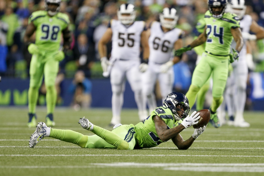 Oct 3, 2019; Seattle, WA, USA; Seattle Seahawks free safety Tedric Thompson (33) intercepts a pass against the Los Angeles Rams during the fourth quarter at CenturyLink Field. Mandatory Credit: Joe Nicholson-USA TODAY Sports