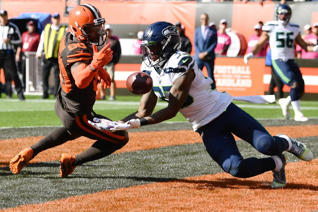 Oct 13, 2019; Cleveland, OH, USA; Seattle Seahawks free safety Tedric Thompson (33) intercepts a pass in the end zone intended for Cleveland Browns wide receiver Jarvis Landry (80) during the first half at FirstEnergy Stadium. Mandatory Credit: Ken Blaze-USA TODAY Sports