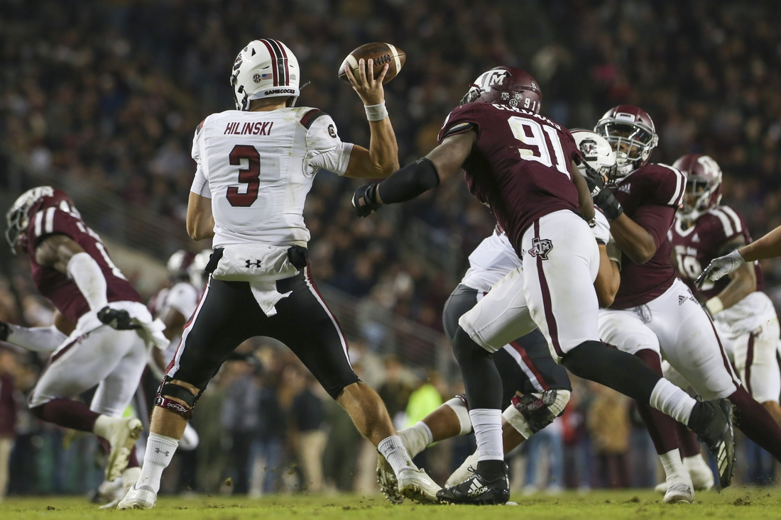 Nov 16, 2019; College Station, TX, USA; South Carolina Gamecocks quarterback Ryan Hilinski (3) looks to throw pursued by Texas A&M Aggies defensive lineman Micheal Clemons (91) during the third quarter at Kyle Field. Mandatory Credit: John Glaser-USA TODAY Sports