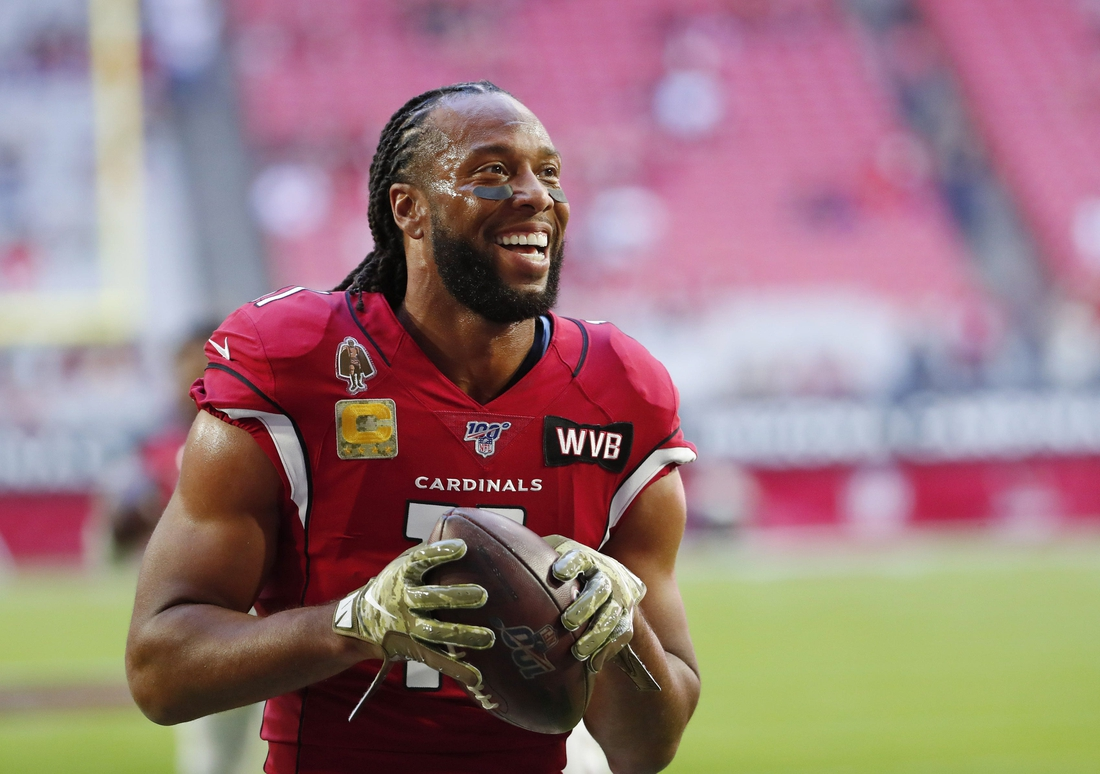 Arizona Cardinals wide receiver Larry Fitzgerald (11) jokes with fans before playing against the Los Angeles Rams at State Farm Stadium December 1, 2019.  Rams Vs Cardinals