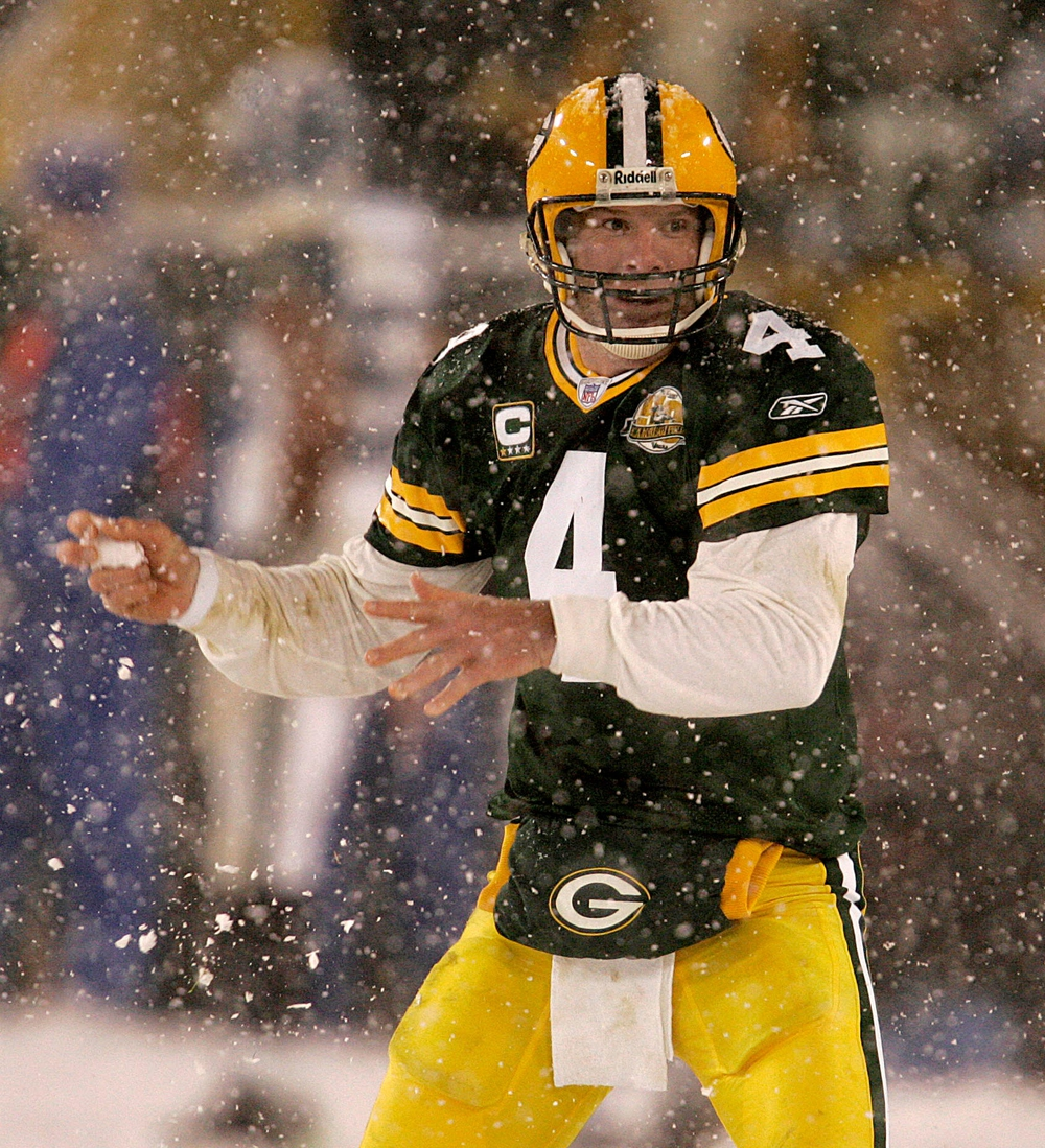 Green Bay Packers quarterback Brett Favre throws a snowball toward teammate  Donald Driver as they celebrate a touch down in the second half during the Green Bay Packers- Seattle Seahawks NFL Playoff game Saturday, January 12, 2008 at Lambeau Field.  Pack13