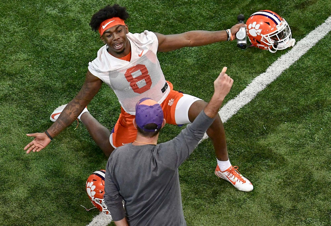 Clemson wide receiver Justyn Ross(8) stretches near head coach Dabo Swinney during Spring practice in Clemson Wednesday, February 26, 2020.  Clemson Football Spring Practice