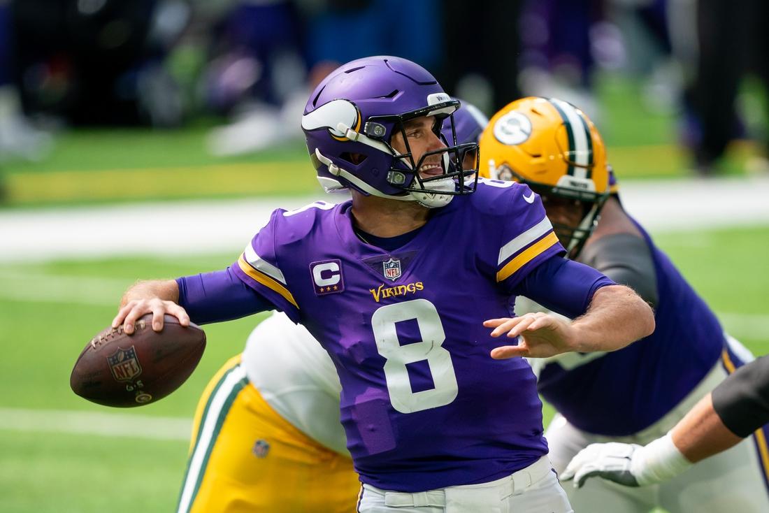 Sep 13, 2020; Minneapolis, Minnesota, USA; Minnesota Vikings quarterback Kirk Cousins (8) passes in the second quarter against the Green Bay Packers at U.S. Bank Stadium. Mandatory Credit: Brad Rempel-USA TODAY Sports