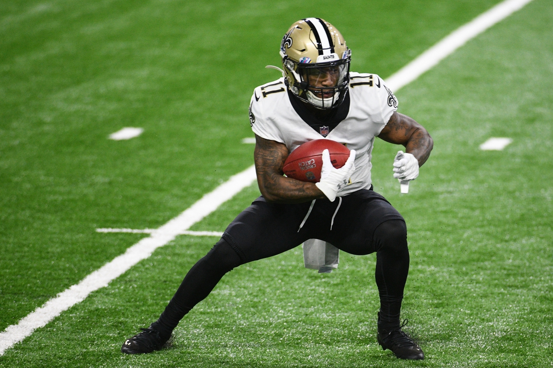 Oct 4, 2020; Detroit, Michigan, USA; New Orleans Saints wide receiver Deonte Harris (11) runs the ball against the Detroit Lions during the first quarter at Ford Field. Mandatory Credit: Tim Fuller-USA TODAY Sports
