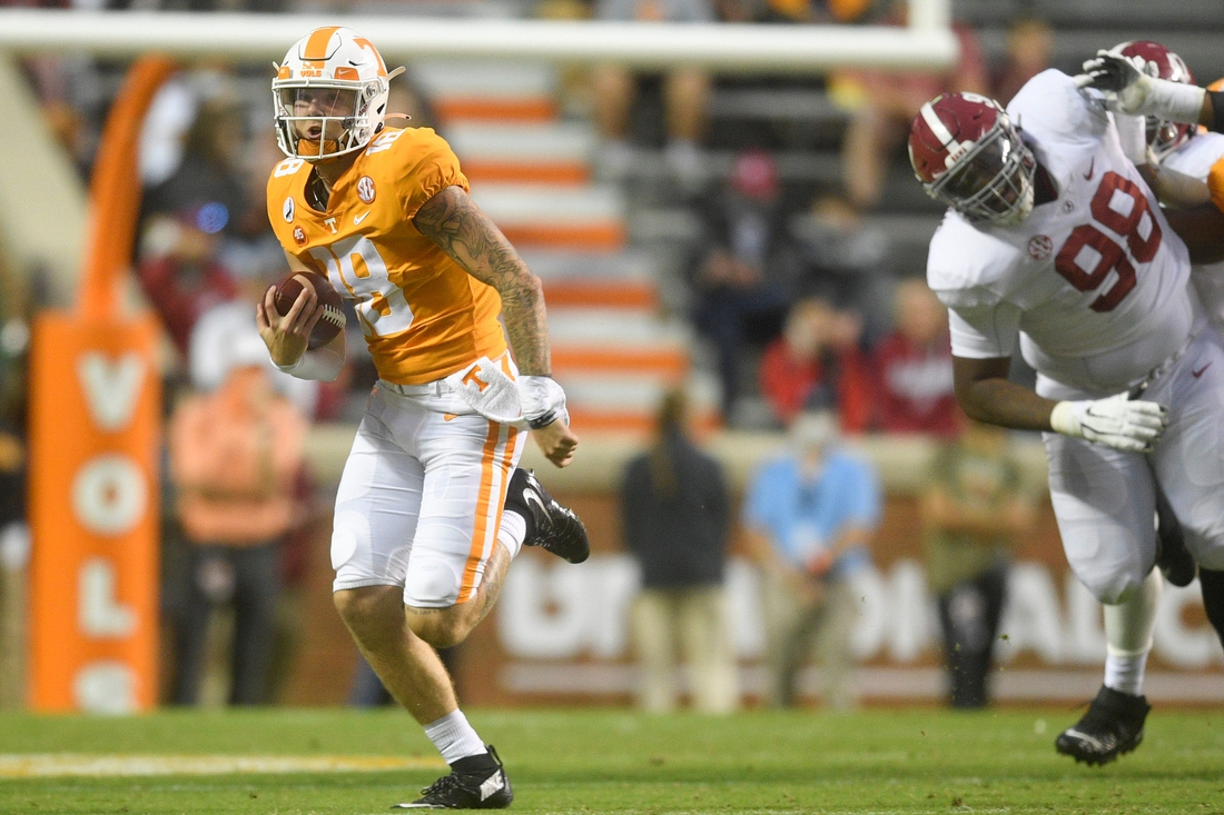 Tennessee quarterback Brian Maurer (18) runs with the ball in the fourth quarter in the second half during a game between Alabama and Tennessee at Neyland Stadium in Knoxville, Tenn. on Saturday, Oct. 24, 2020.  102420 Ut Bama Gameaction