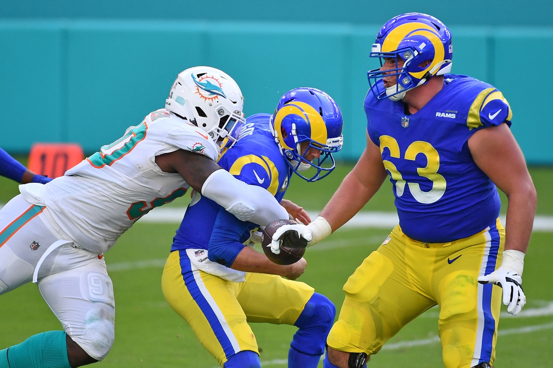 Nov 1, 2020; Miami Gardens, Florida, USA; Miami Dolphins defensive end Shaq Lawson (90) forces the fumble of Los Angeles Rams quarterback Jared Goff (16) during the first half at Hard Rock Stadium. Mandatory Credit: Jasen Vinlove-USA TODAY Sports