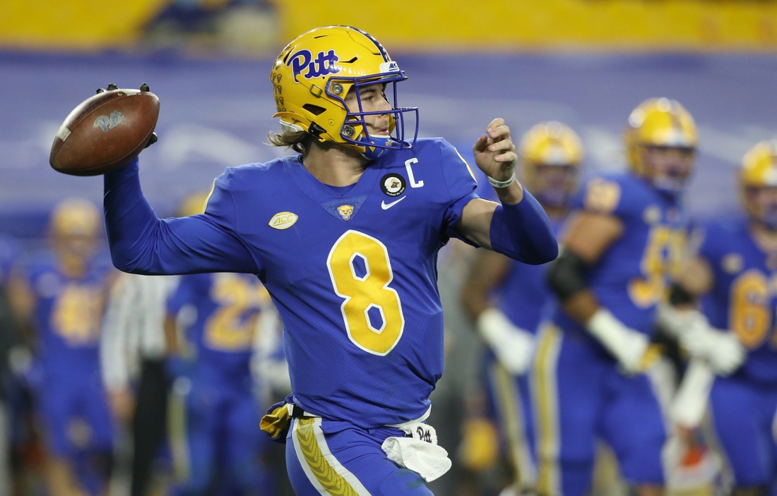 Nov 21, 2020; Pittsburgh, Pennsylvania, USA;  Pittsburgh Panthers quarterback Kenny Pickett (8) passes against the Virginia Tech Hokies during the second quarter at Heinz Field. Pittsburgh won 47-14. Mandatory Credit: Charles LeClaire-USA TODAY Sports