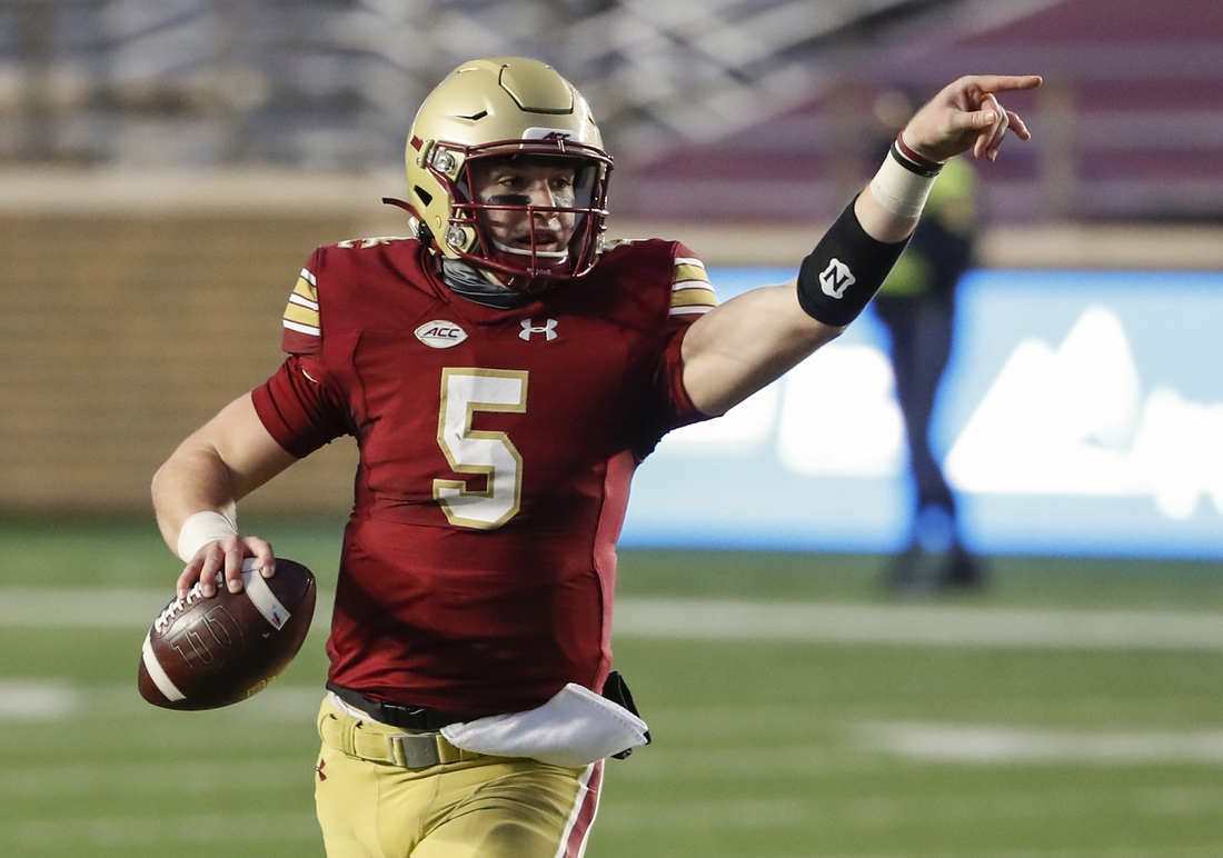 Nov 28, 2020; Chestnut Hill, Massachusetts, USA; Boston College Eagles quarterback Phil Jurkovec (5) directs his receivers during the first half against the Louisville Cardinals at Alumni Stadium. Mandatory Credit: Winslow Townson-USA TODAY Sports