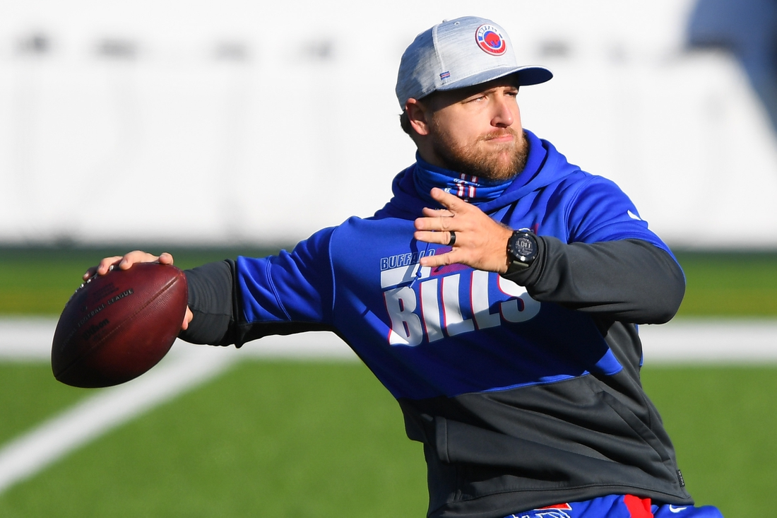 Nov 29, 2020; Orchard Park, New York, USA; Buffalo Bills quarterback Matt Barkley (5) warms up prior to the game against the Los Angeles Chargers at Bills Stadium. Mandatory Credit: Rich Barnes-USA TODAY Sports