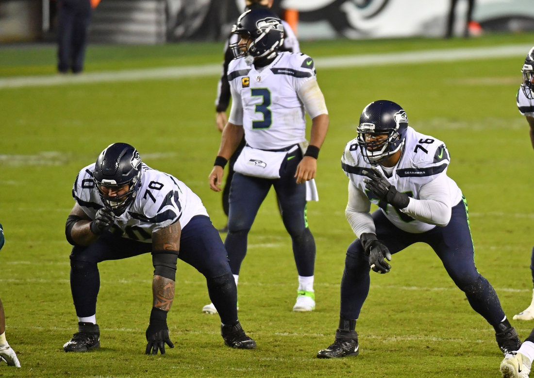 Nov 30, 2020; Philadelphia, Pennsylvania, USA; Seattle Seahawks offensive guard Mike Iupati (70) and offensive tackle Duane Brown (76) wait for the snap against the Philadelphia Eagles at Lincoln Financial Field. Mandatory Credit: Eric Hartline-USA TODAY Sports